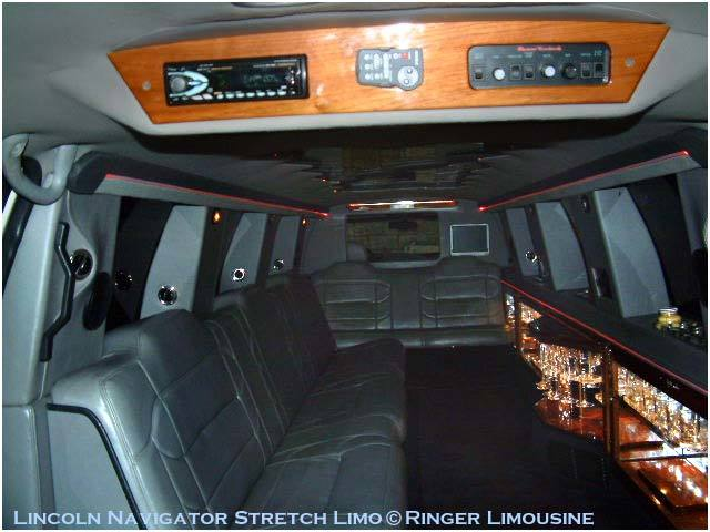 [Image: The Lincoln Navigator limo: fun, festive and world class limo service! ]