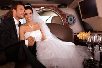 Bride & groom inside limo
